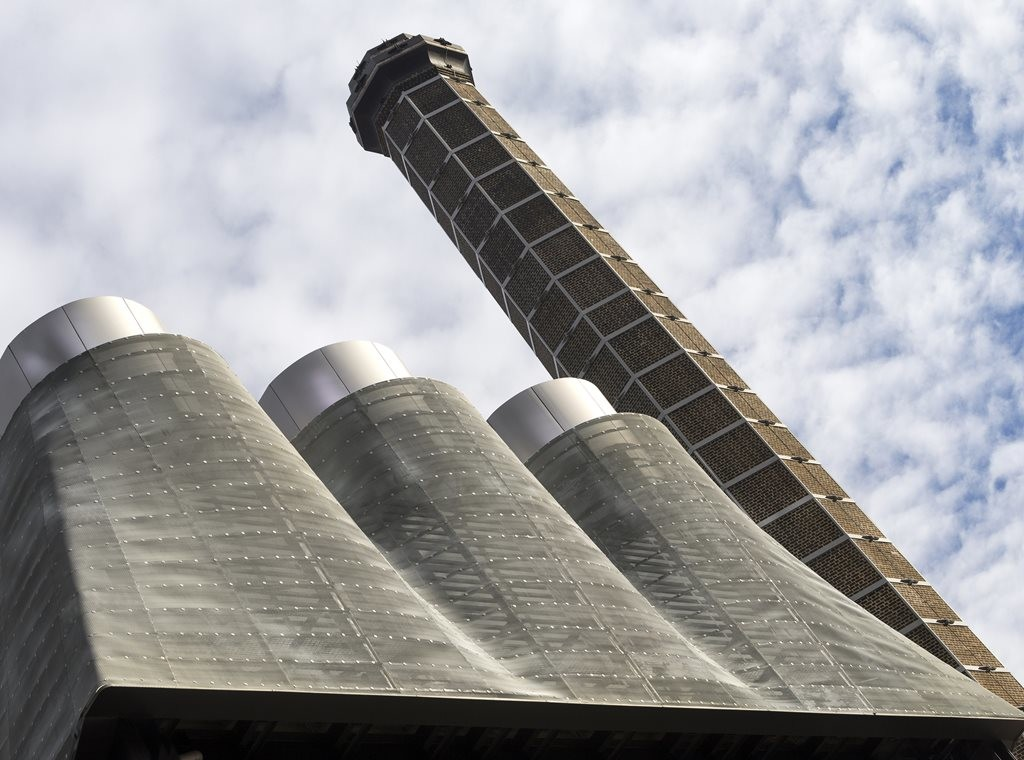 Tzannes Associates hide trigeneration cooling towers with zinc mesh netting at Irving Street Brewery