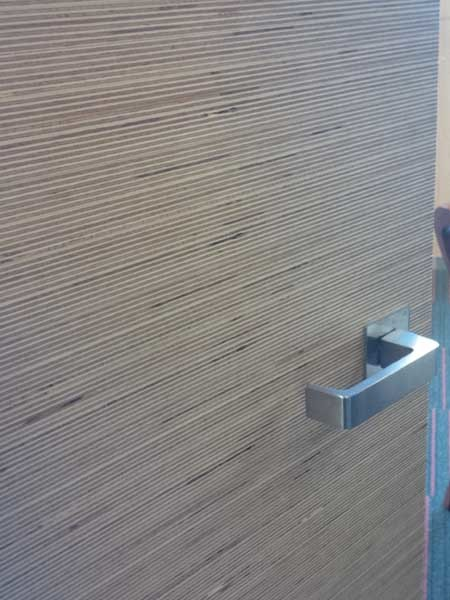 The Langwarrin Hotel door featuring MAXI Edge panels with a crossgrain effect