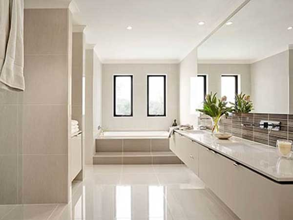 One of the recent trends in bathroom design is to install large format tiles