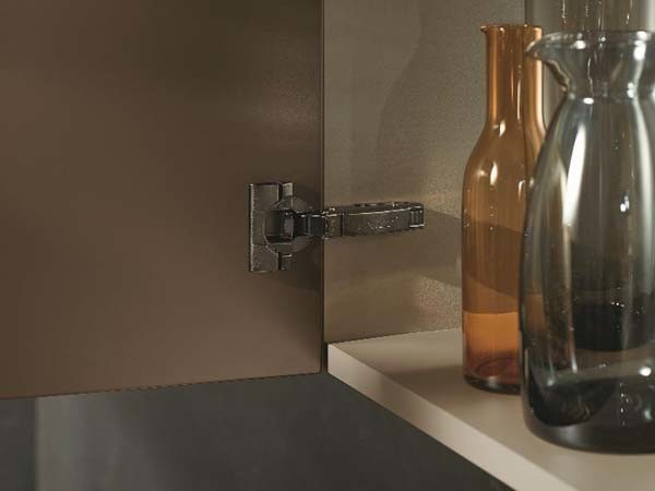 CLIP top BLUMOTION in Onyx Black integrates harmoniously into darker cabinets. (Photo by Blum)