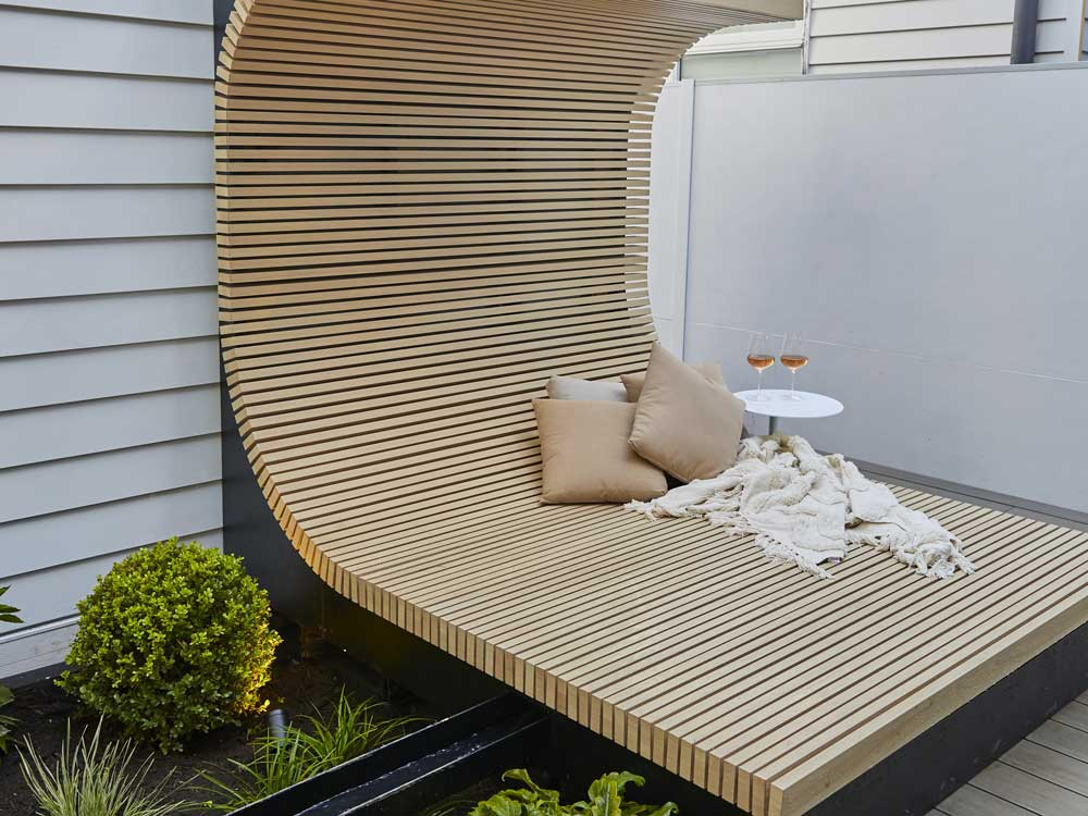 The daybed created from DecoWood timber look aluminium battens