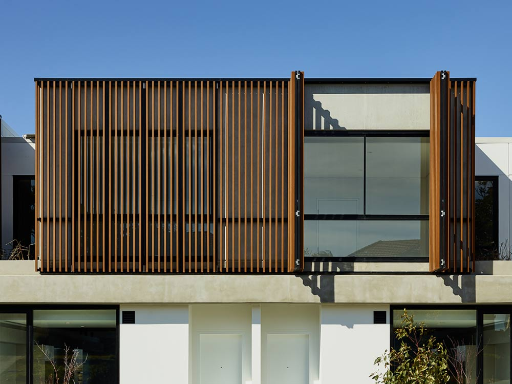 Exterior facade image of residential building with wood plastic cladding
