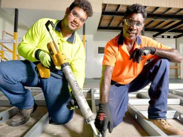 Ausco first year apprentice Fredrick McGilbary (left) being shown the ropes by Gus Logan. Photo courtesy of the Courier Mail
