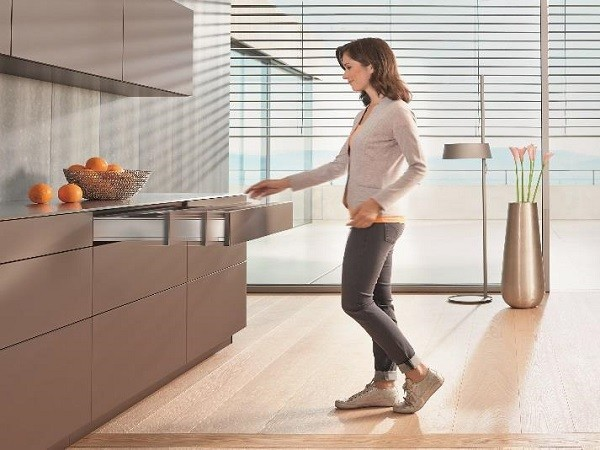TIP-ON BLUMOTION brings enhanced user convenience to kitchens with handle-less fronts. (Photo by Blum)