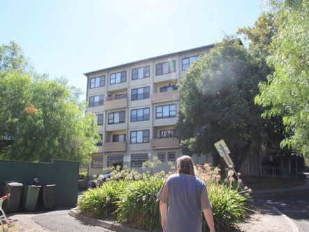 Will Gwynne walks through one of the nine Melbourne estates that is being sold in the public housing 'renewal' program. Image: David Kelly, author-provided