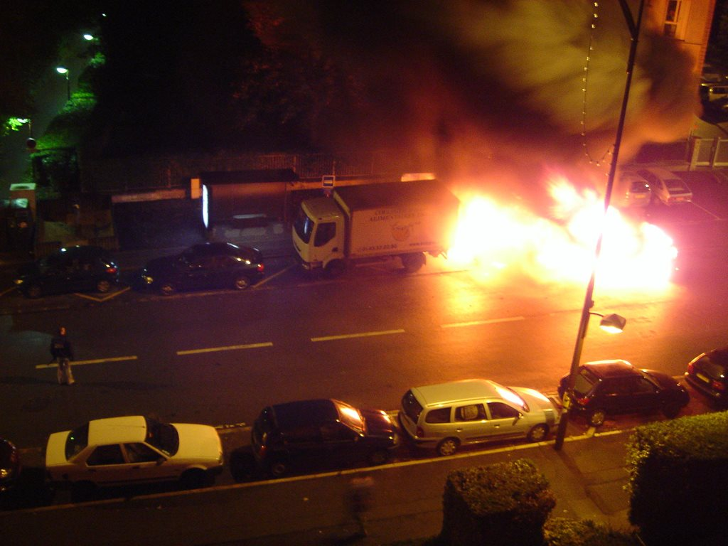 A car is set alight during the 2005 riots that prompted soul-searching in France about segregated and badly designed housing projects. Image: A.J./Wikimedia, CC BY-SA