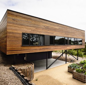 Blairgowrie House by Wolveridge Architects perches on sand dune with help of robust materials