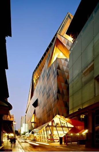 Said That With Its Sculpted Gold Roof Harlequin Facade And Raking Atrium Culminating In What Must Now Be Our Citys Premier Contemporary Retail Space